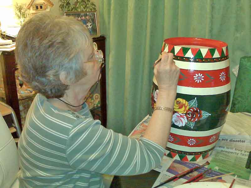 TRINA PAINTING A BARREL
